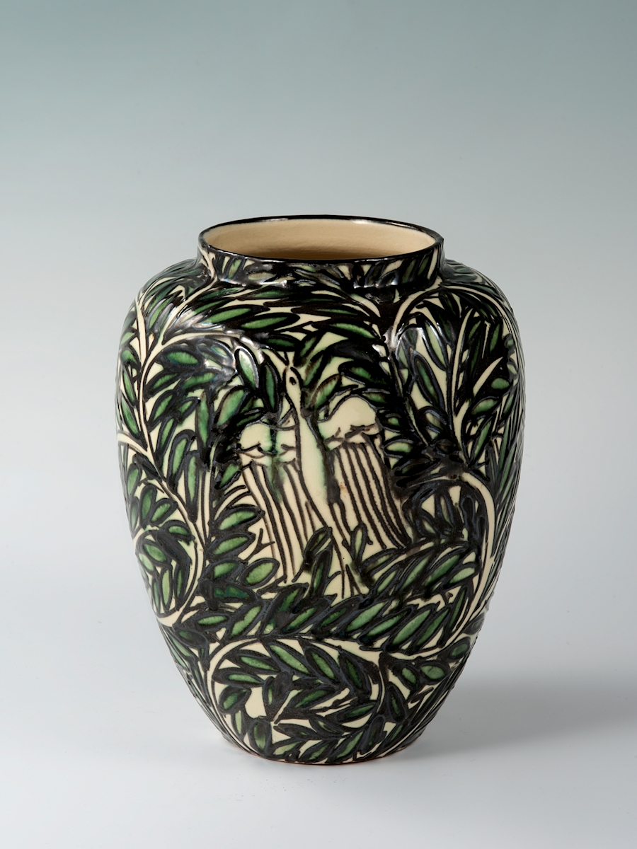 Laeuger vase bird, deer, dog and branches